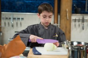 Chef contestant, Eitan Bernath competes during a segment, as seen on Food Network's Chopped, Season 21.